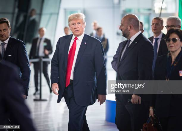 President Donald Trump walks through the new NATO Headquarters on the first day of the North Atlantic Treaty Organization summit in Brussels on July...