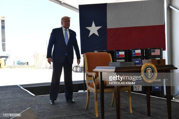 President Donald Trump walks to a desk to sign permits for energy development in the Permian basin in Midland, Texas on July 29, 2020.
