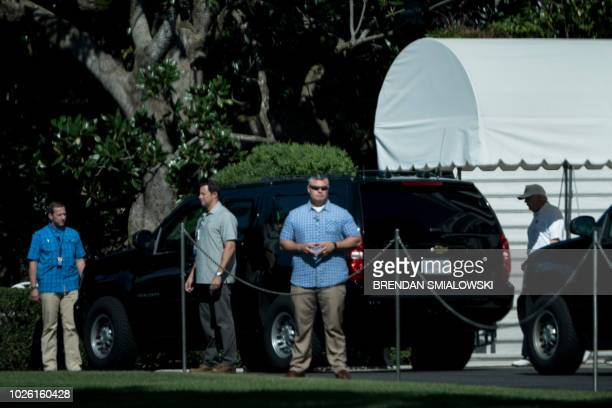 US President Donald Trump walks to a motorcade to travel to the Trump National Golf Club from the White House September 2 2018 in Washington DC