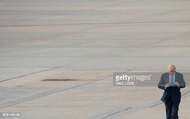 President Donald Trump walks to Air Force One prior to departure from Andrews Air Force Base in Maryland August 3 as Trump travels to a rally in...