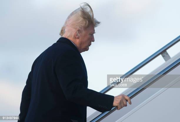 US President Donald Trump walks to Air Force One prior to departure from Joint Base Andrews in Maryland February 2 as he travels to Mar a Lago in...
