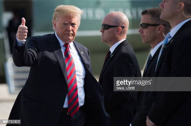 President Donald Trump walks to Air Force One prior to departure from Joint Base Andrews in Maryland, June 8, 2018. - Trump travels to Canada to...