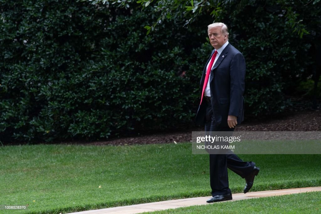 US President Donald Trump walks to board Marine One at the White House in Washington, DC, on July 31, 2018, as he departs for Florida.