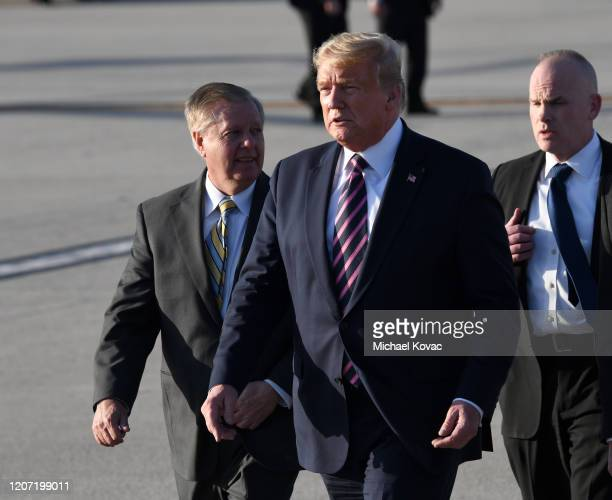 S President Donald Trump walks to greet supporters after arriving on Air Force One at LAX Airport on February 18 2020 in Los Angeles California