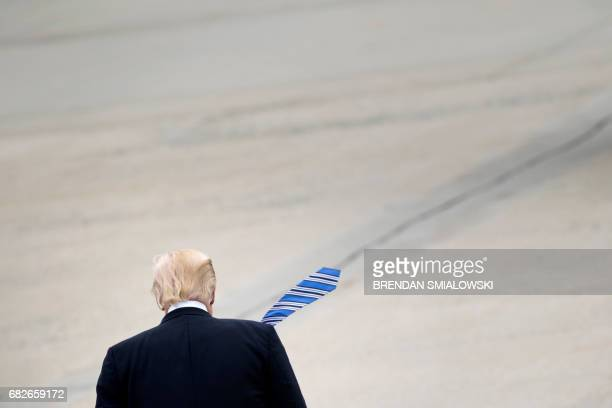 US President Donald Trump walks to Marine One at Andrews Air Force Base May 13 2017 in Maryland / AFP PHOTO / Brendan Smialowski