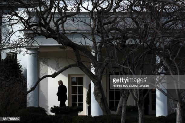 President Donald Trump walks to Marine One for his first trip as President on the South Lawn of the White House January 26 2017 in Washington DC /...
