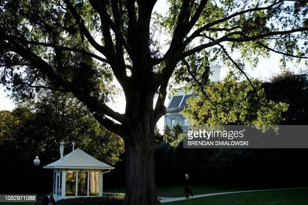 US President Donald Trump walks to Marine One on the South Lawn of the White House October 24 2018 in Washington DC Trump is travelling to Mosinee...
