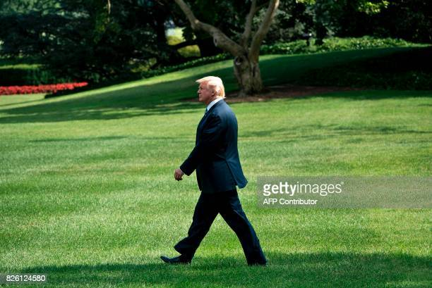 US President Donald Trump walks to Marine One on the South Lawn of the White House August 3 in Washington DC The president is traveling to Huntington...