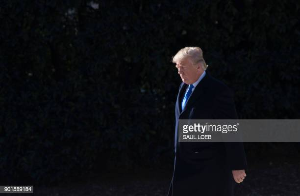 US President Donald Trump walks to Marine One prior to departing from the South Lawn of the White House in Washington DC January 5 as he travels for...