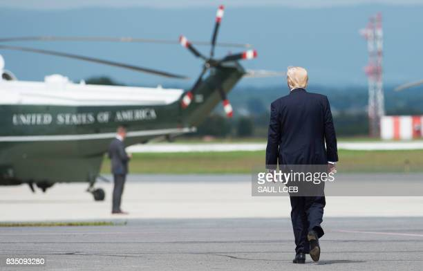US President Donald Trump walks to Marine One upon arrival at Hagerstown Regional Airport in Hagerstown Maryland August 18 as he travels for meetings...