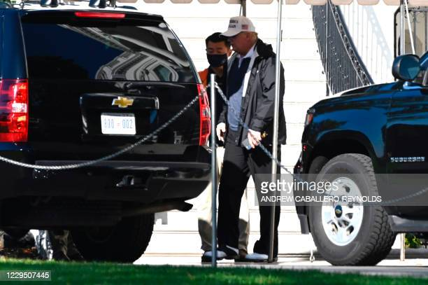 President Donald Trump walks to the motorcade on the South Lawn of the White House in Washington, DC, on November 7 as he departs for an undisclosed...