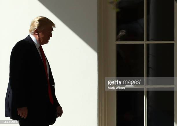 S President Donald Trump walks to the Oval Office after arriving back at the White House on February 24 2017 in Washington DC President Trump made...