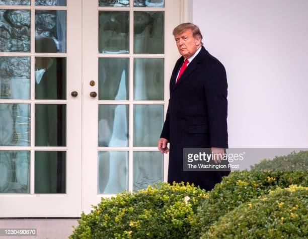 December 31: President Donald Trump walks to the Oval Office after he and First Lady Melania Trump arrive on the South Lawn of the White House after...