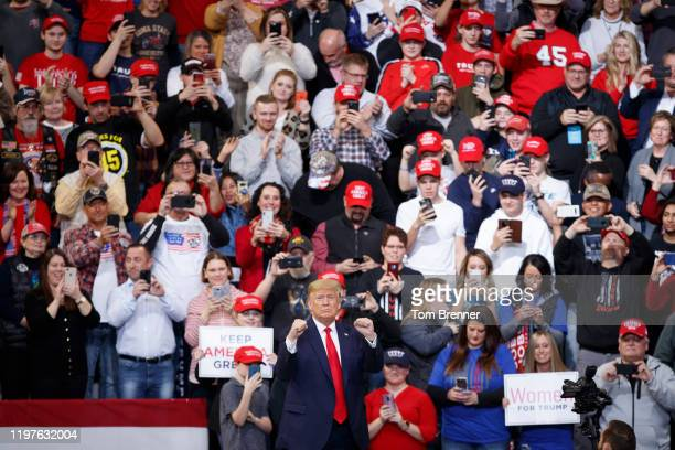 President Donald Trump walks to the podium before speaking at a campaign rally inside of the Knapp Center arena at Drake University on January 30,...