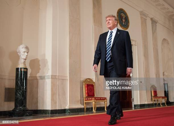 US President Donald Trump walks to the podium to announce his nominee to the Supreme Court at the White House in Washington DC on January 31 2017...