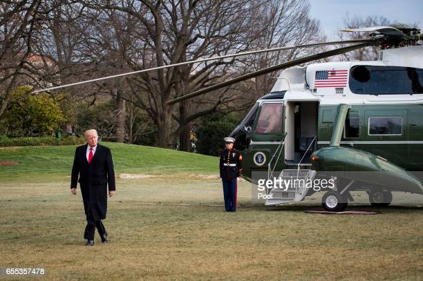 President Donald Trump walks to the residence after disembarking from Marine One on the South Lawn of the White House on March 19 2017 in Washington...