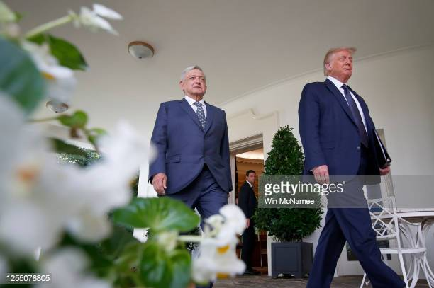 S President Donald Trump walks to the Rose Garden with Mexican President Andrés Manuel López Obrador at the White House July 8 2020 in Washington DC...