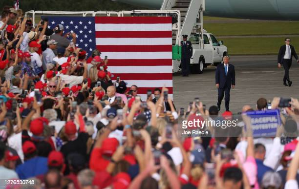 President Donald Trump walks to the stage after arriving on Air Force One for his 'The Great American Comeback Rally' at Cecil Airport on September...