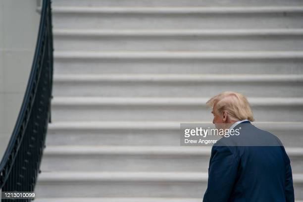 S President Donald Trump walks to the White House residence after exiting Marine One on the South Lawn of the White House on May 14 2020 in...