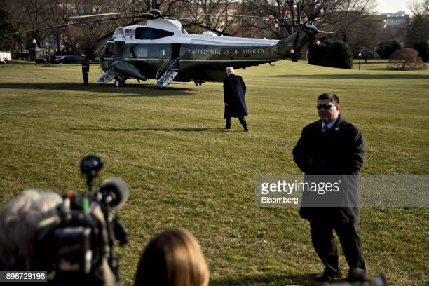US President Donald Trump walks toward Marine One on the South Lawn of the White House in Washington DC US on Thursday Dec 21 2017 Trump is traveling...