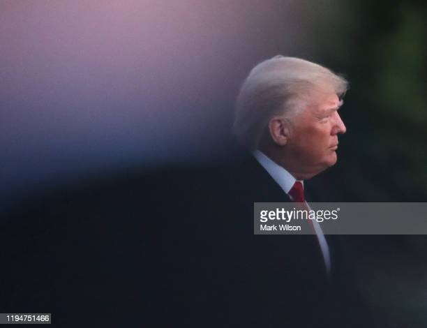 S President Donald Trump walks toward Marine One prior to his departure for a campaign event in Battle Creek Michigan December 18 2019 at the White...