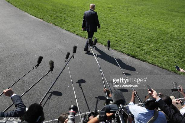 S President Donald Trump walks toward the waiting Marine One after talking to members of the news media before departing the White House May 25 2018...