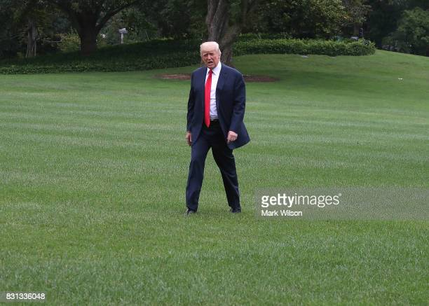 President Donald Trump walks toward the White House after stepping off of Marine One on the South Lawn on August 14 2017 in Washington DC Later today...