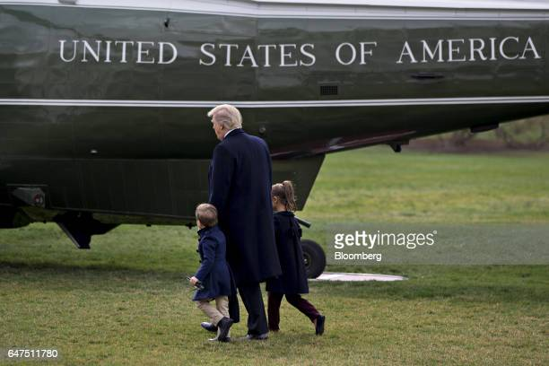 US President Donald Trump walks towards Marine One on the South Lawn of the White House with his grandchildren Arabella Kushner right and Joseph...