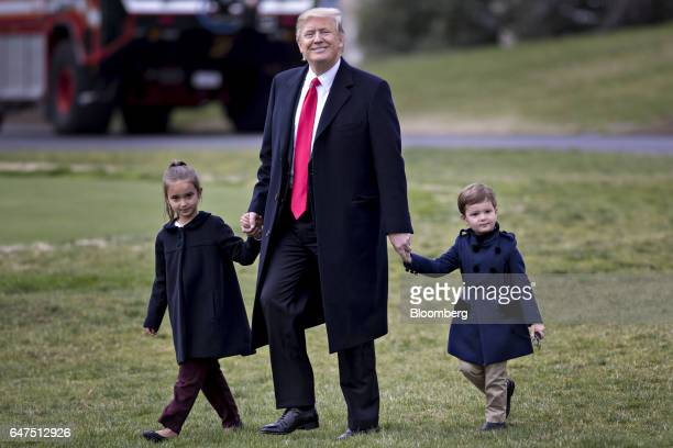 US President Donald Trump walks towards Marine One on the South Lawn of the White House with his grandchildren Arabella Kushner left and Joseph...