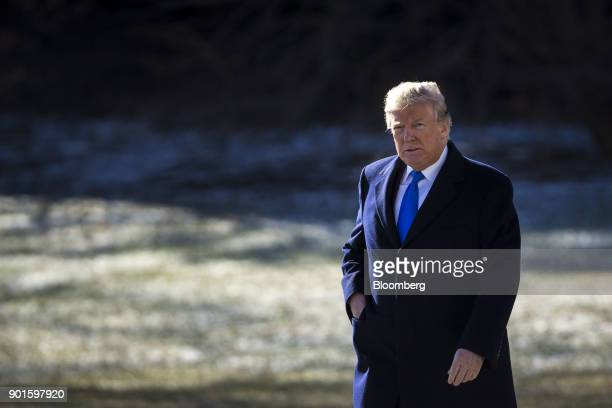 US President Donald Trump walks towards Marine One on the South Lawn of the White House in Washington DC US on Friday Jan 5 2018 Trump is traveling...