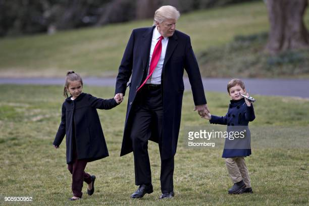 S President Donald Trump walks towards Marine One on the South Lawn of the White House with his grandchildren Arabella Kushner left and Joseph...