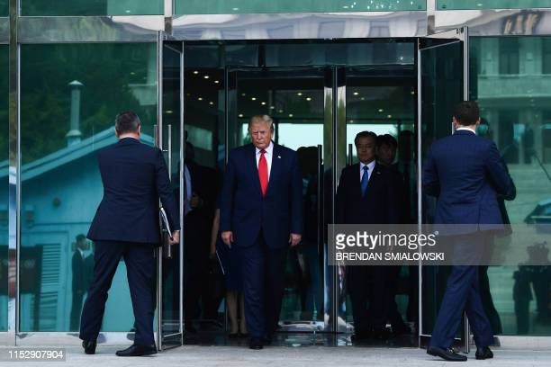 US President Donald Trump walks towards the Military Demarcation Line that divides North and South Korea for a meeting with North Korea's leader Kim...