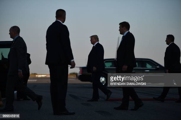 US President Donald Trump walks towards the Presidential car upon arrival at HelsinkiVantaa Airport in Helsinki on July 15 2018 on the eve of a...