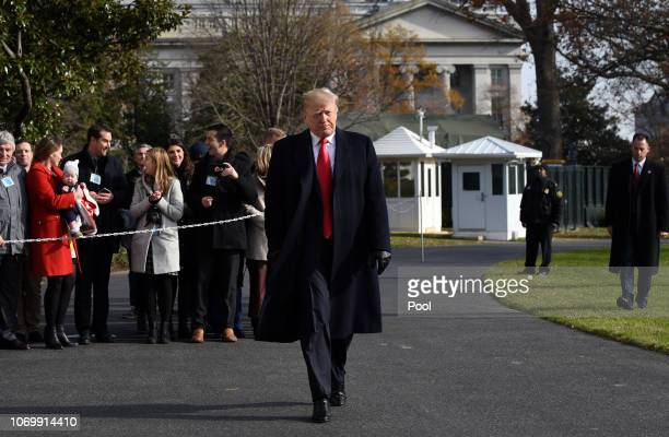 US President Donald Trump walks towards the press while departing the White House December 8 2018 in Washington DC Trump says White House chief of...