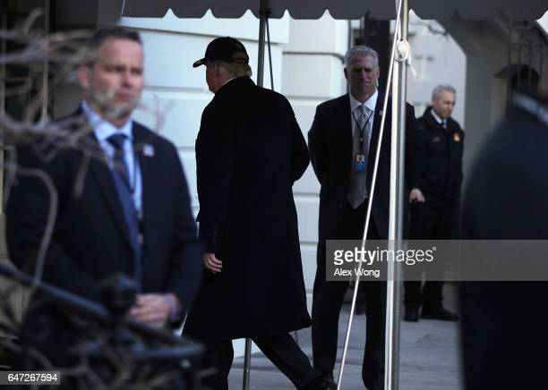 S President Donald Trump walks towards the residence after he returned to the White House March 2 2017 in Washington DC President Trump has returned...