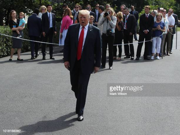 S President Donald Trump walks up to the media before departing on Marine One to travel to New York at the White House on August 17 2018 in...