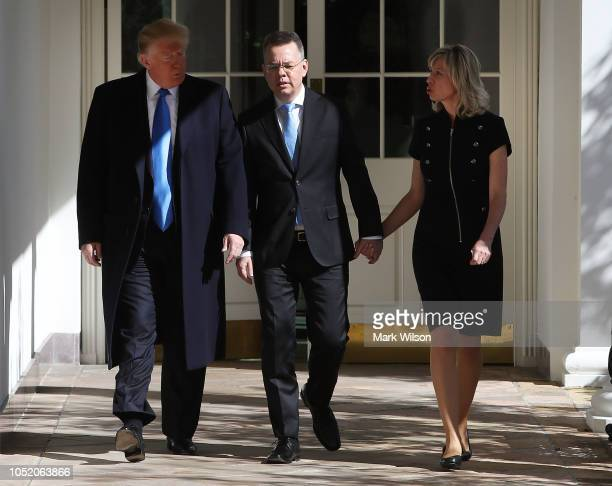 S President Donald Trump walks with American evangelical Christian preacher Andrew Brunson and his wife Norine Brunson to a meeting in the Oval...