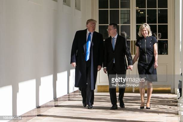 US President Donald Trump walks with American evangelical Christian preacher Andrew Brunson and his wife Norine Brunson to a meeting in the Oval...