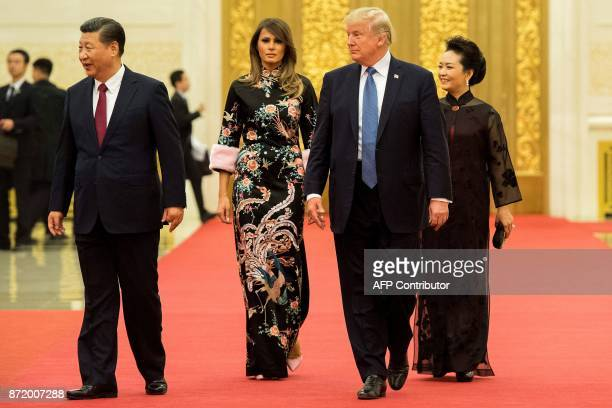 US President Donald Trump walks with China's President Xi Jinping US First Lady Melania Trump and Xi's wife Peng Liyuan in the Great Hall of the...