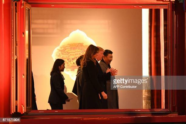 US President Donald Trump walks with First Lady Melania Trump and China's President Xi Jinping during a tour of the Forbidden City in Beijing on...