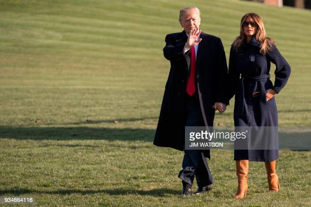 President Donald Trump walks with First Lady Melania Trump on the South Lawn upon their return to the White House in Washington DC on March 19 2018 /...