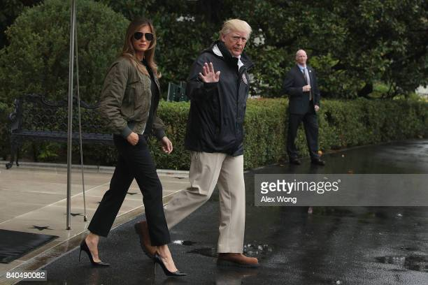 S President Donald Trump walks with first lady Melania Trump prior to their Marine One departure from the White House August 29 2017 in Washington DC...