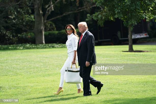 S President Donald Trump walks with first lady Melania Trump towards Marine One on the South Lawn of the White House July 27 2018 in Washington DC...