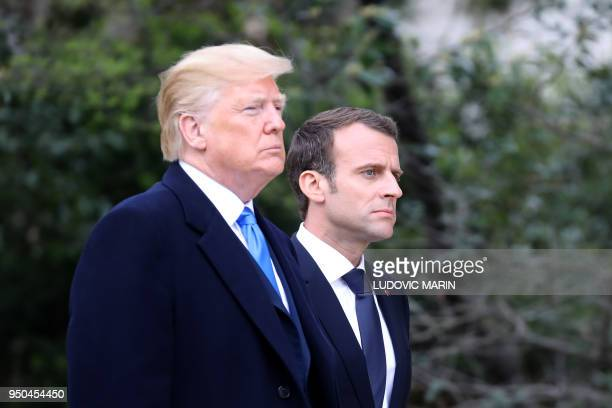 President Donald Trump walks with French President Emmanuel Macron at Mount Vernon the estate of the first US President George Washington in Mount...