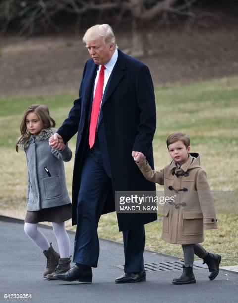 US President Donald Trump walks with grandchildren Arabella Kushner and Joseph Kushner to board Marine One from the South Lawn of the White House on...