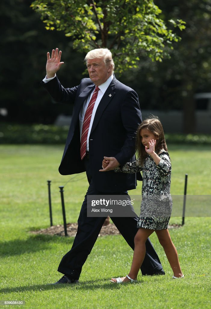 U.S. President Donald Trump walks with granddaughter Arabella Rose Kushner towards the Marine One on the South Lawn of the White House prior to a departure August 25, 2017 in Washington, DC. President Trump is spending the weekend with his family at Camp David.
