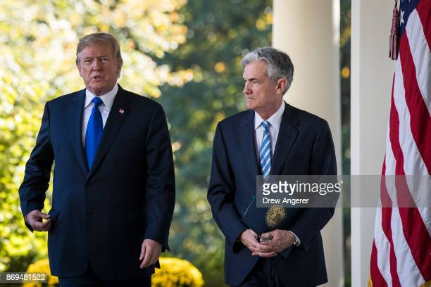 US President Donald Trump walks with his nominee for the chairman of the Federal Reserve Jerome Powell on their way to a press event in the Rose...