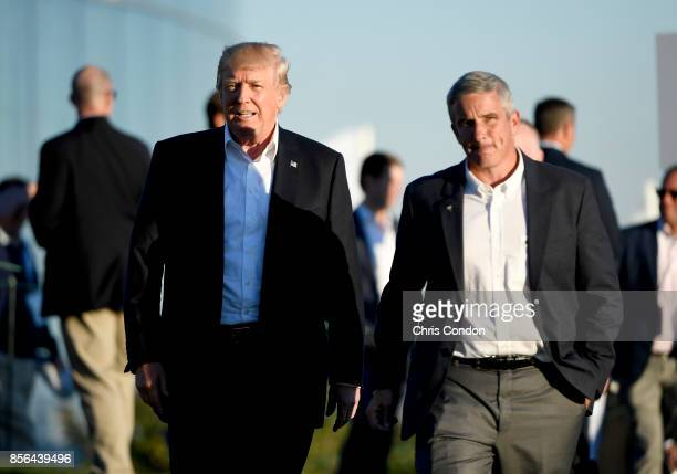 President Donald Trump walks with Jay Monahan PGA TOUR Commissioner after the US Team defeated the International Team 19 to 11 in the Presidents Cup...
