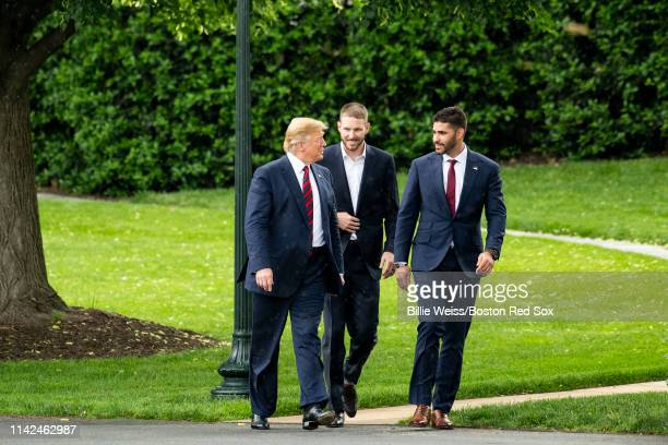 President Donald Trump walks with J.D. Martinez and Chris Sale of the Boston Red Sox during a visit to the White House in recognition of the 2018...