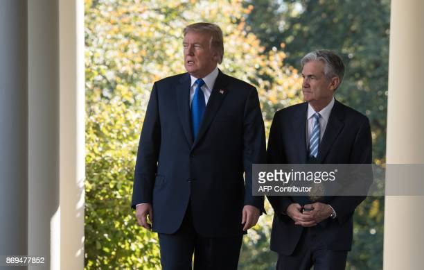 US President Donald Trump walks with Jerome Powell his nominee to be Federal Reserve chairman at the White House in Washington DC on November 2 2017...